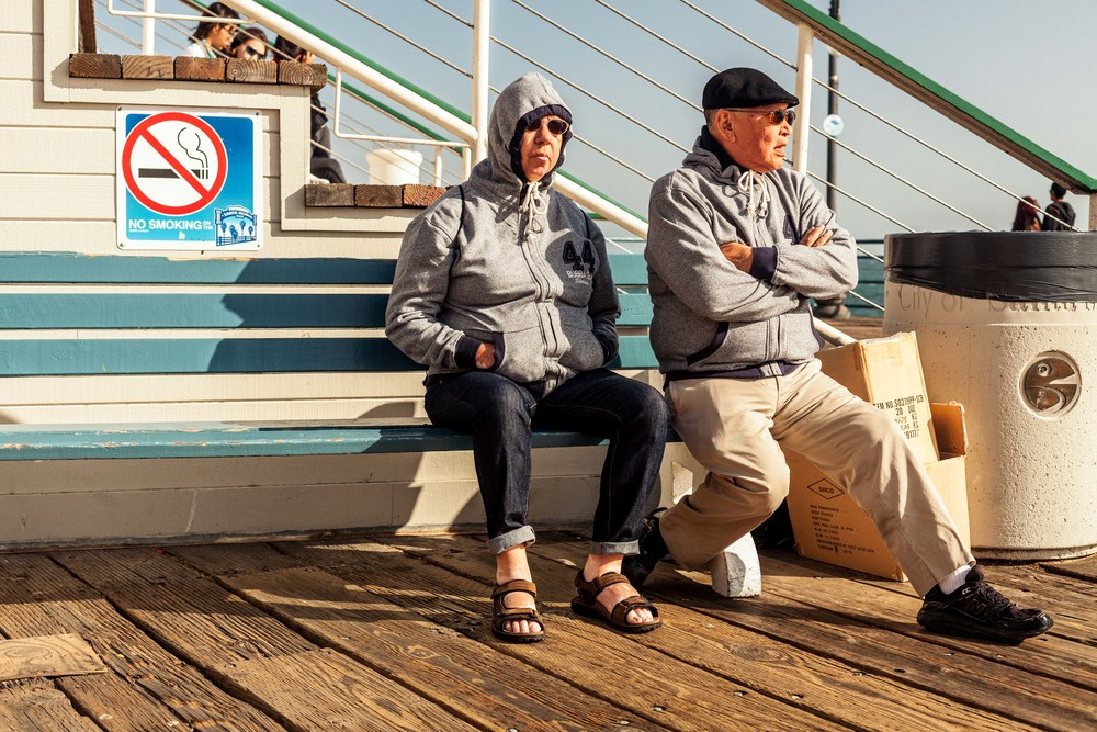 an older couple sits on a bench.jpg