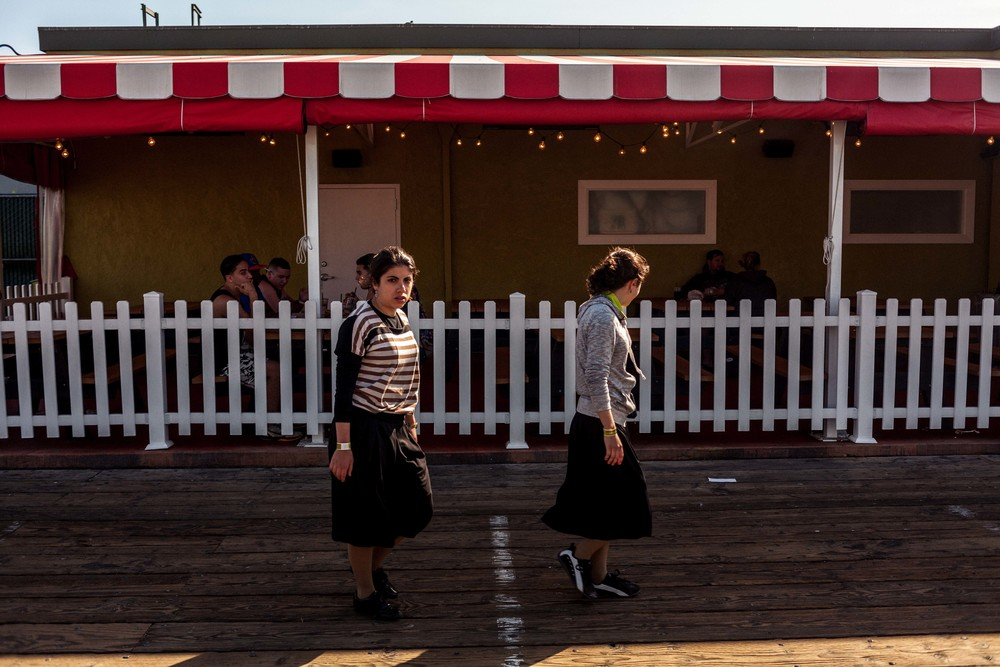 two sisters walk past a restaurant.jpg