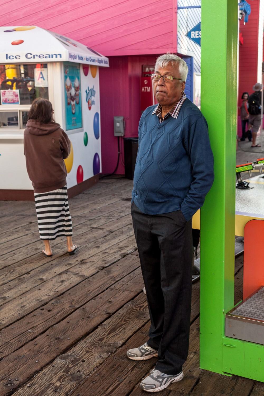 a man leans against a pole.jpg