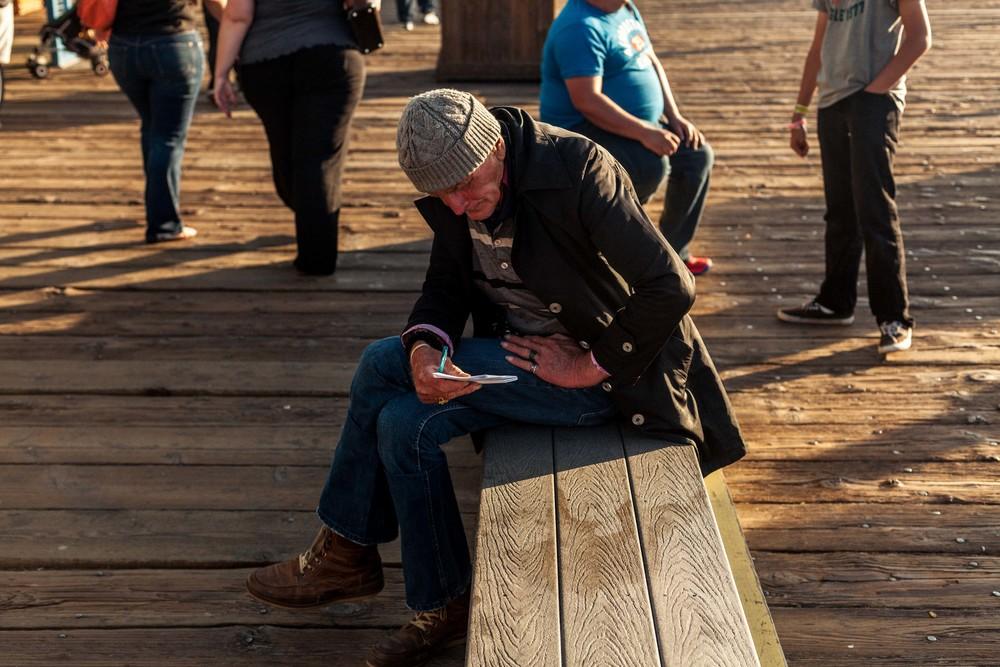 an older man checks his notes.jpg