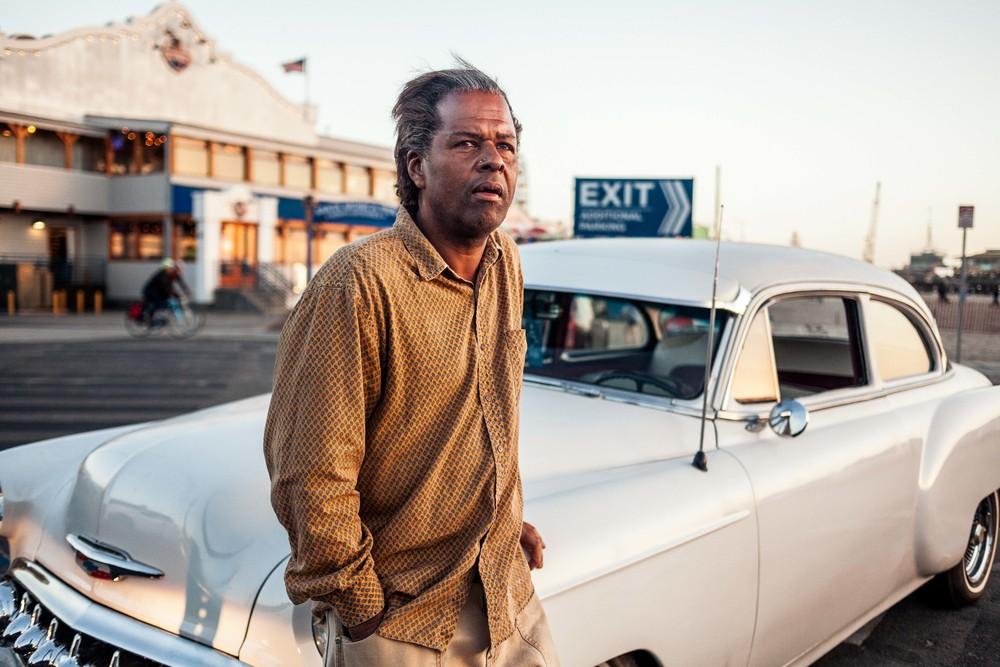 Harold leans against his car.jpg