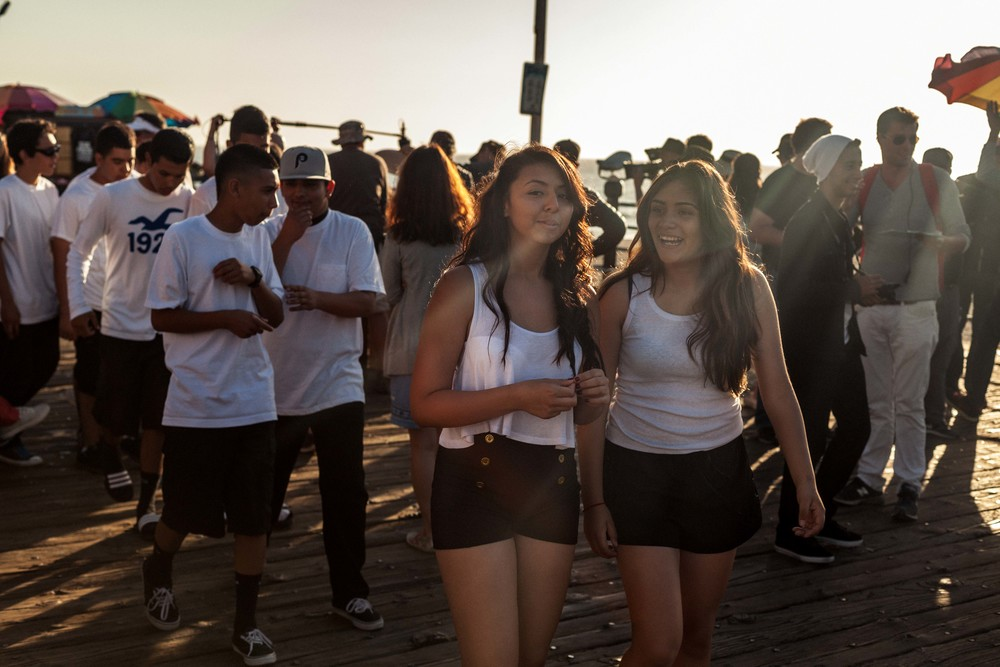 two teenage girls walk and talk.jpg