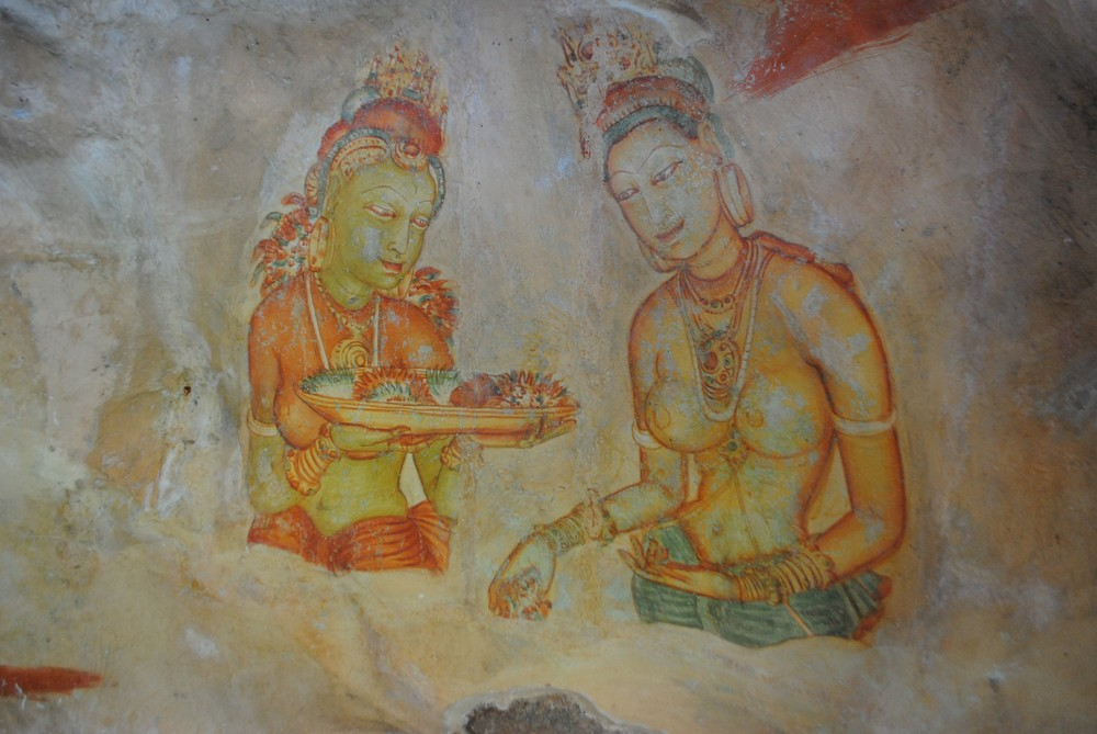 A fresco at the ancient site of Sigiriya. Fruit and flower offerings have long been a part of Sri Lankan Buddhism.