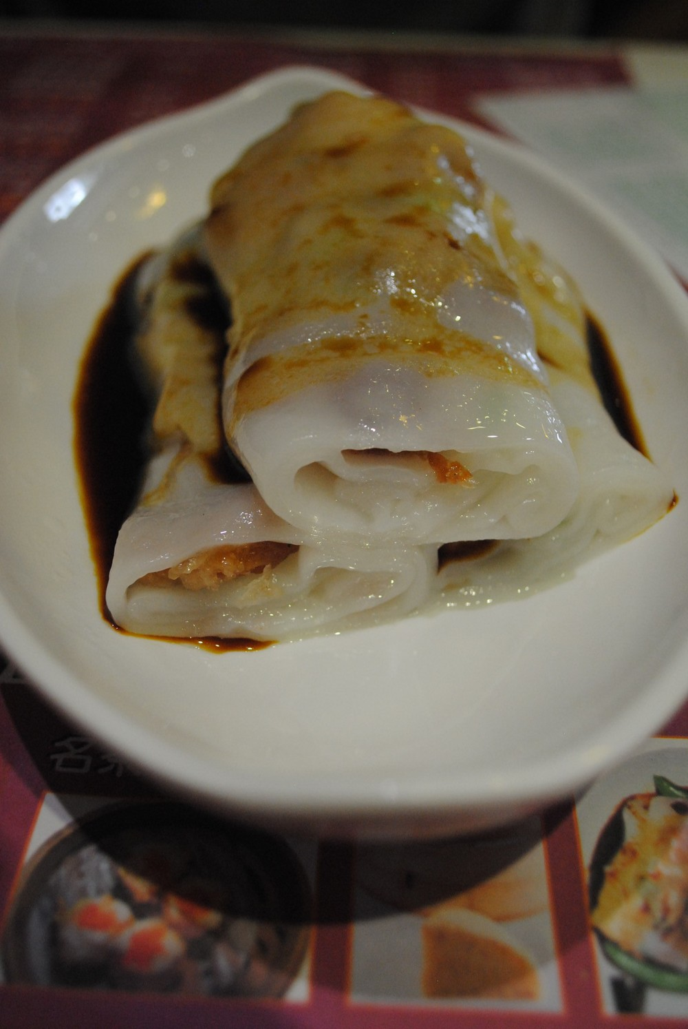 Steamed rice sheets filled with bbq pork.