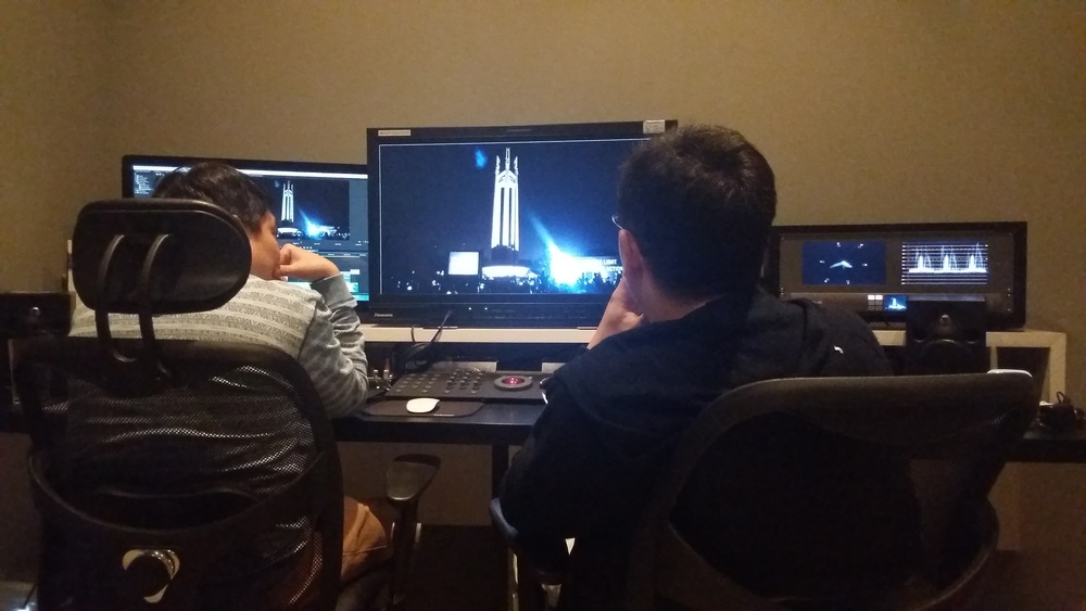 Chris and Producer Chao sifting through footage sent in