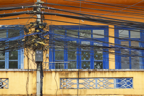 a-tangle-of-cables-and-wires-on-front-of-window.png