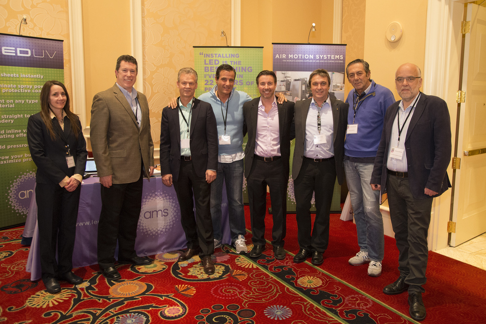 Platinum sponsor Air Motion Systems, Inc. (AMS) showcasing their sponsor table at Print UV 2015.