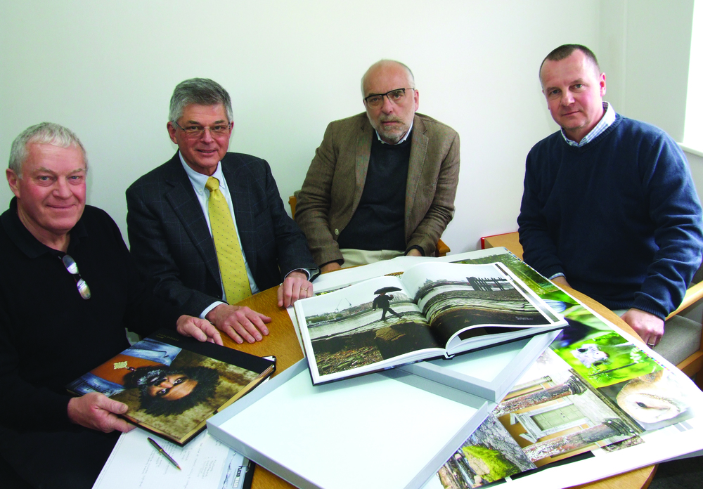 From Left: Jim Lunt (Opal Print Director), Claus Nielsen (AMS UK), Carsten Barlebo (AMS European MD) and Keith Lunt (Opal Print MD) with The South Bank Tower book featuring photography by Steve McCurry.