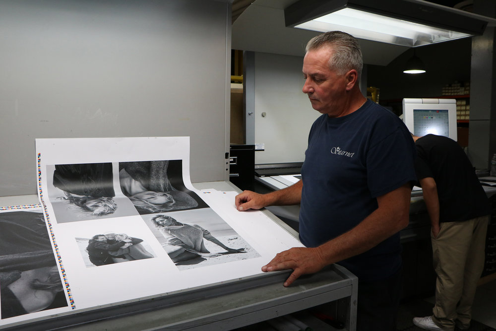 Cullen checks a proof from a high-fashion print job cured with Air Motion Systems' LED UV system.