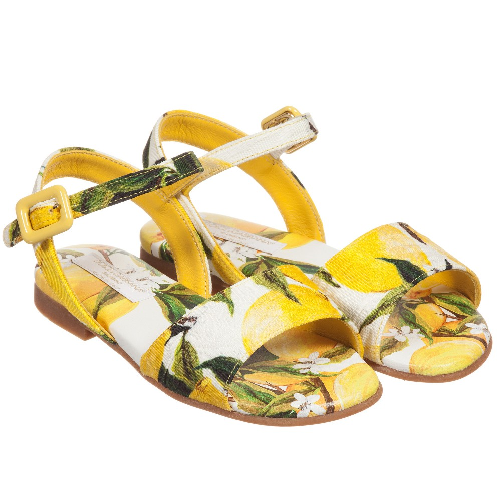 Perfect for any outfit, these sandals are especially fun for the lemonade stand. - Dolce & Gabbana Girls Yellow Brocade Lemon Print Sandals                                                          childrensalon.com                                                  $347