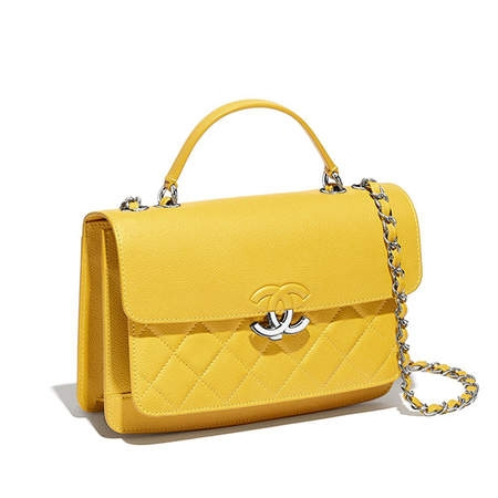 Brighten your neutral handbag collection and carry your essentials in a refreshing yellow bag this summer! - Chanel Flap Bag                                                     chanel.com                                                              $3,000