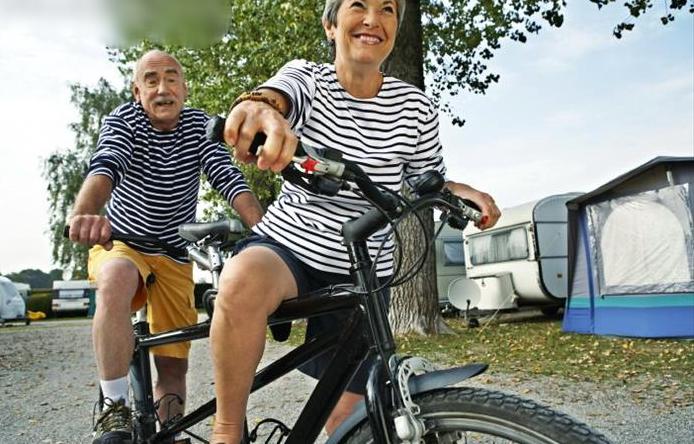 couple riding in tandem bike.jpg