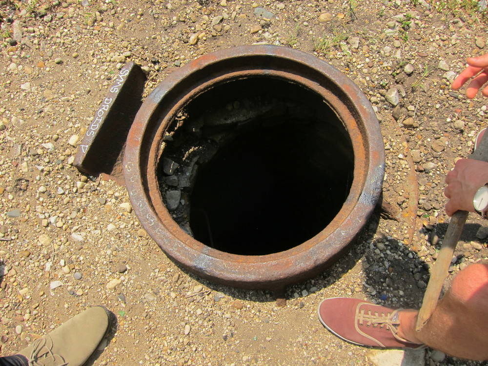A random well-like hole in the ground (there were a handful of big holes like this).