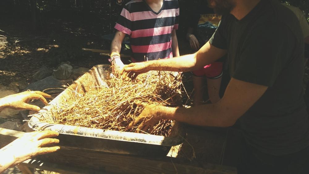 Making a straw/slip mixture.