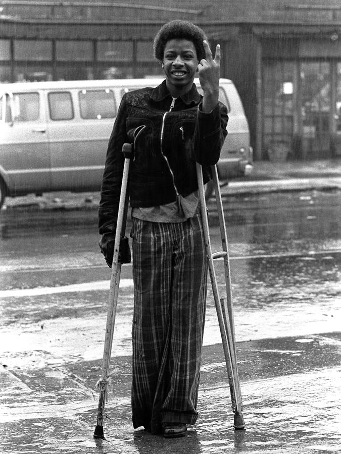 #80 V sign on crutches.jpg