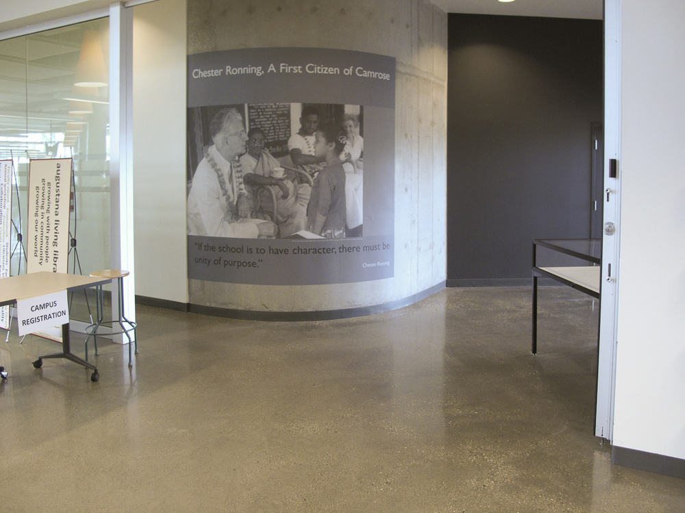 Wall graphic on curved raw concrete wall employing Photo Tex at Augustana Campus University of Alberta