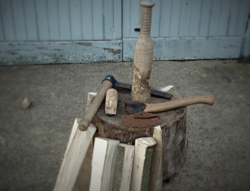 A froe, block, hand axe and club