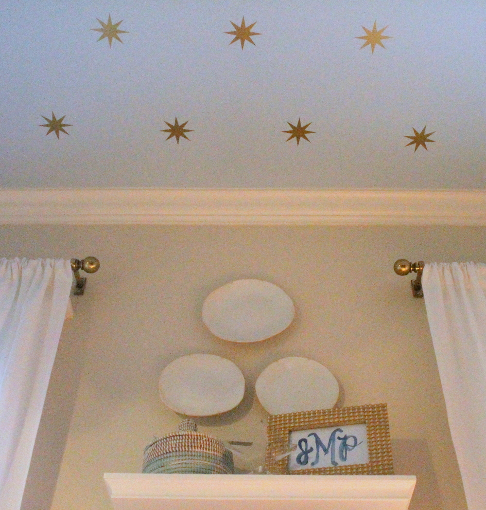 Sophisticated navy and aqua nursery.   Decor and starred ceiling detail.   Houston, Texas
