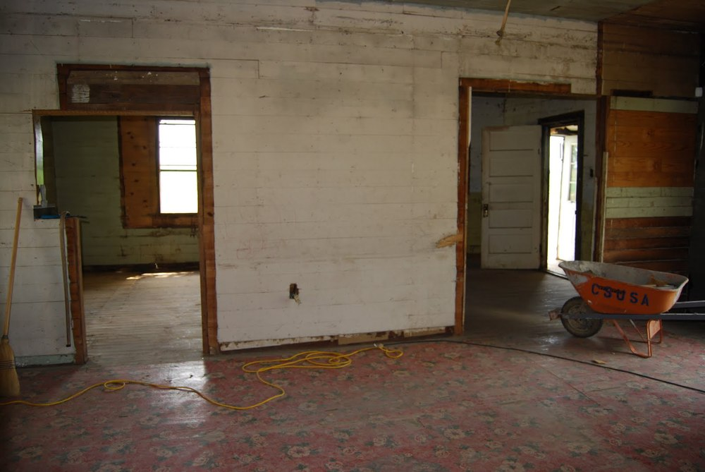 Interior looking towards kitchen and dining rooms prior to restoration