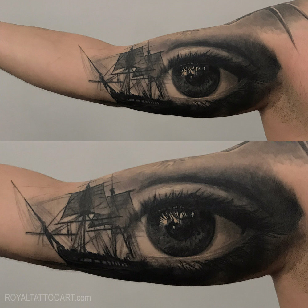 EYe tattoo inner arm black and grey realistic realism boat water seal .jpg