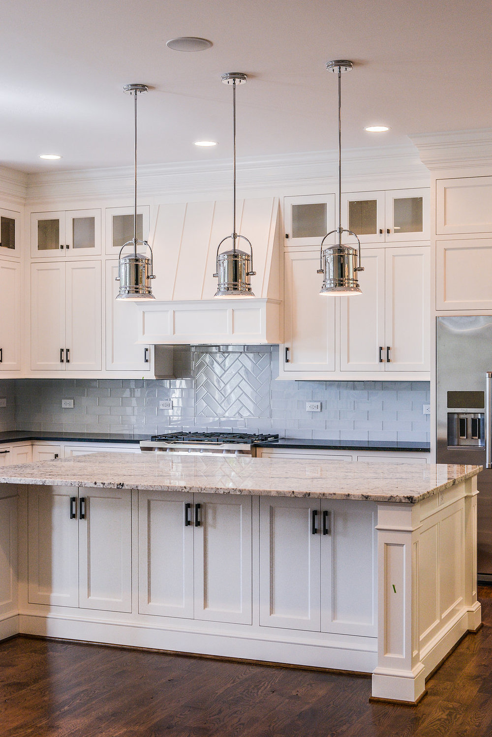 Carrera marble counterops,  professional grade appliances, and custom cabinets by Martin Star