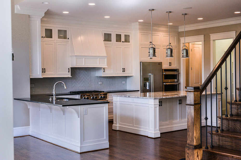 The gourmet kitchen opens up to an informal dining area, playroom, and family room.