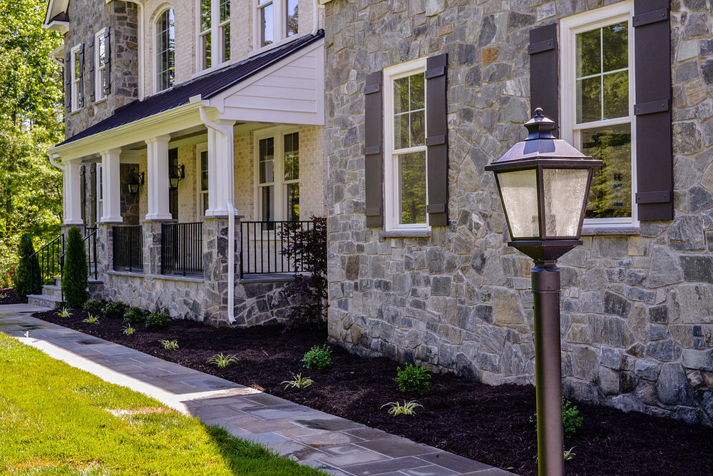 The beautiful stone walkway invites you right to the front door