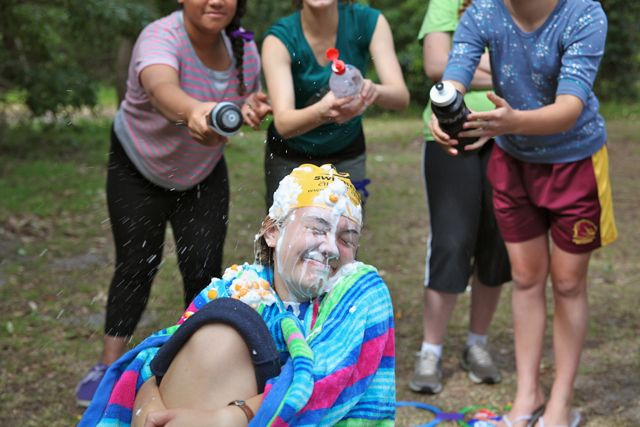 A ridiculously funny game where one poor member of each team is subjected to shaving cream, thrown cheeto balls, and squirted water. Maddy was a good sport.