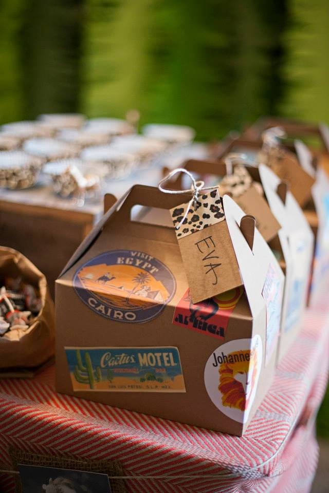 The favor boxes were a Hobby Lobby find for $1/box - WIN. We decorated them with vintage travel stickers and a name tag for each kiddo.