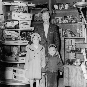 WITH FATHER AND SISTER IN A CHINATOWN, SAN FRANCISCO CAMERA STORE. 1957