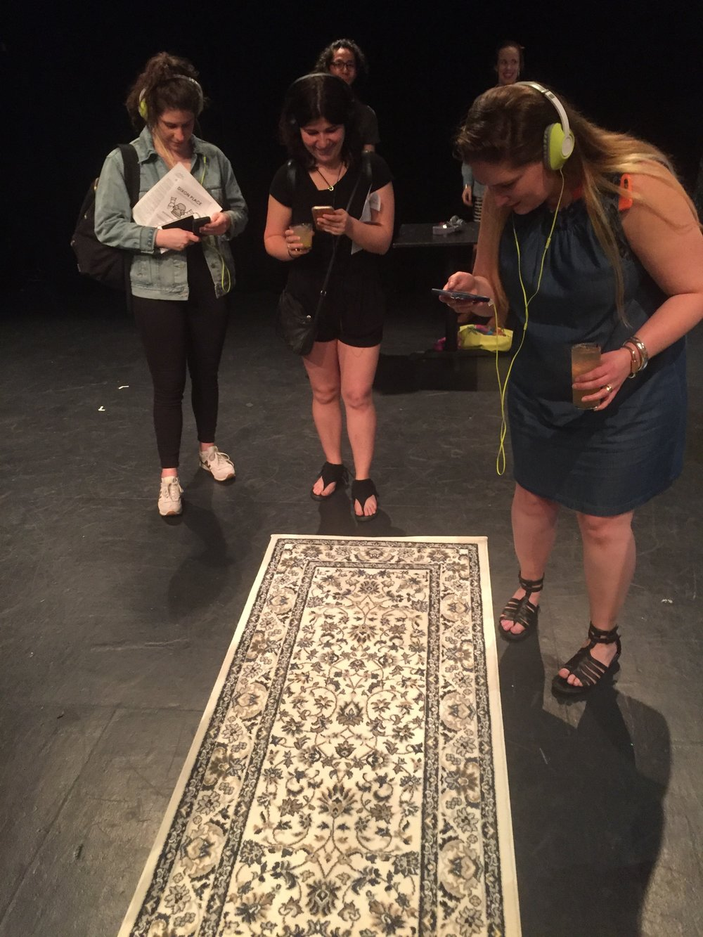 Audience members try the app