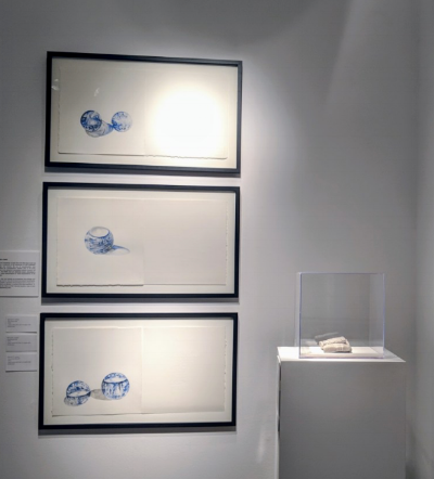 "Drawings by Marcia Cohen on wall, and cast of a cuneiform tablet on pedestal in ""Beyond Words."" (Photo: Terry Kearns)"