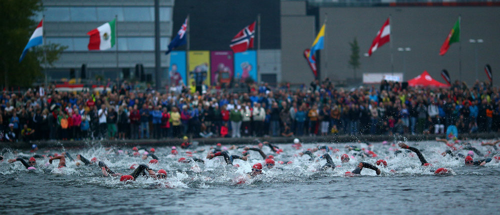 ALMERE, NETHERLANDS - SEPTEMBER 13: Participants compete in the swim leg of the race during The Challenge Triathlon Almere-Amsterdam on September 13, 2014 in Almere, Netherlands. (Photo by Charlie Crowhurst/Getty Images for Challenge Triathlon) *** Local Caption *** ;