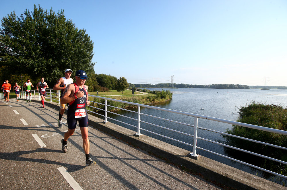 ALMERE, NETHERLANDS - SEPTEMBER 13: Participants compete in the run leg of the race during The Challenge Triathlon Almere-Amsterdam on September 13, 2014 in Almere, Netherlands. (Photo by Charlie Crowhurst/Getty Images for Challenge Triathlon) *** Local Caption *** ;