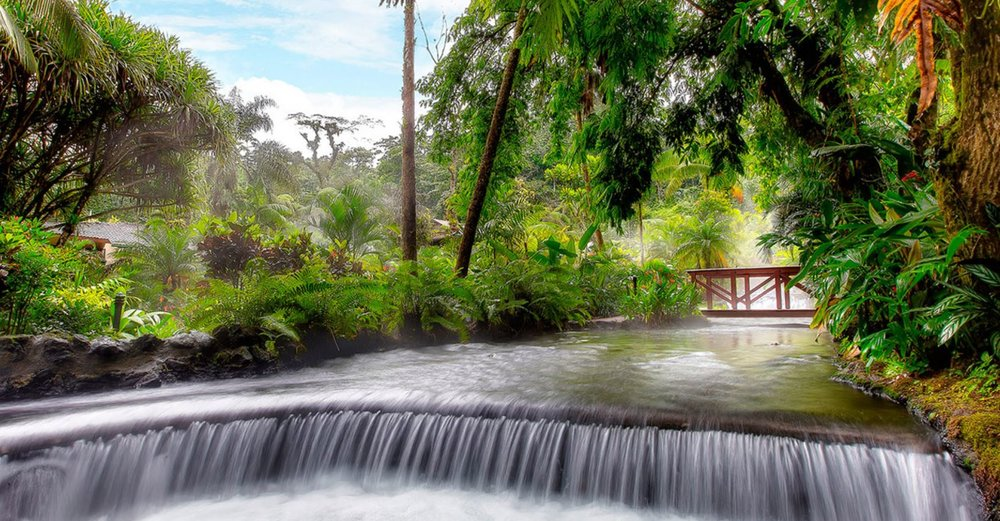 INCLUDED: the ultimate recovery day trip to Mt. Arenal volcano and Tabacon thermal springs.