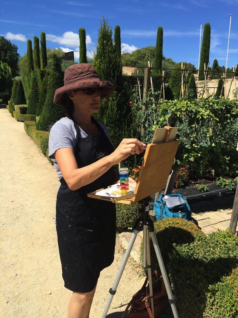 Noreen Coup painting a scene on location in France.
