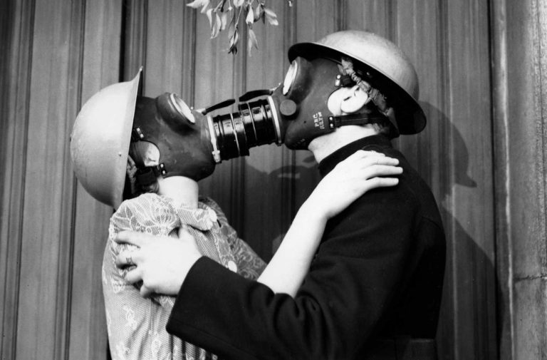 a-couple-kissing-under-the-mistletoe-wearing-gas-masks-e1464332850767.jpg