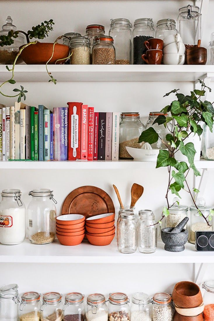 Add color to a neutral kitchen with books.