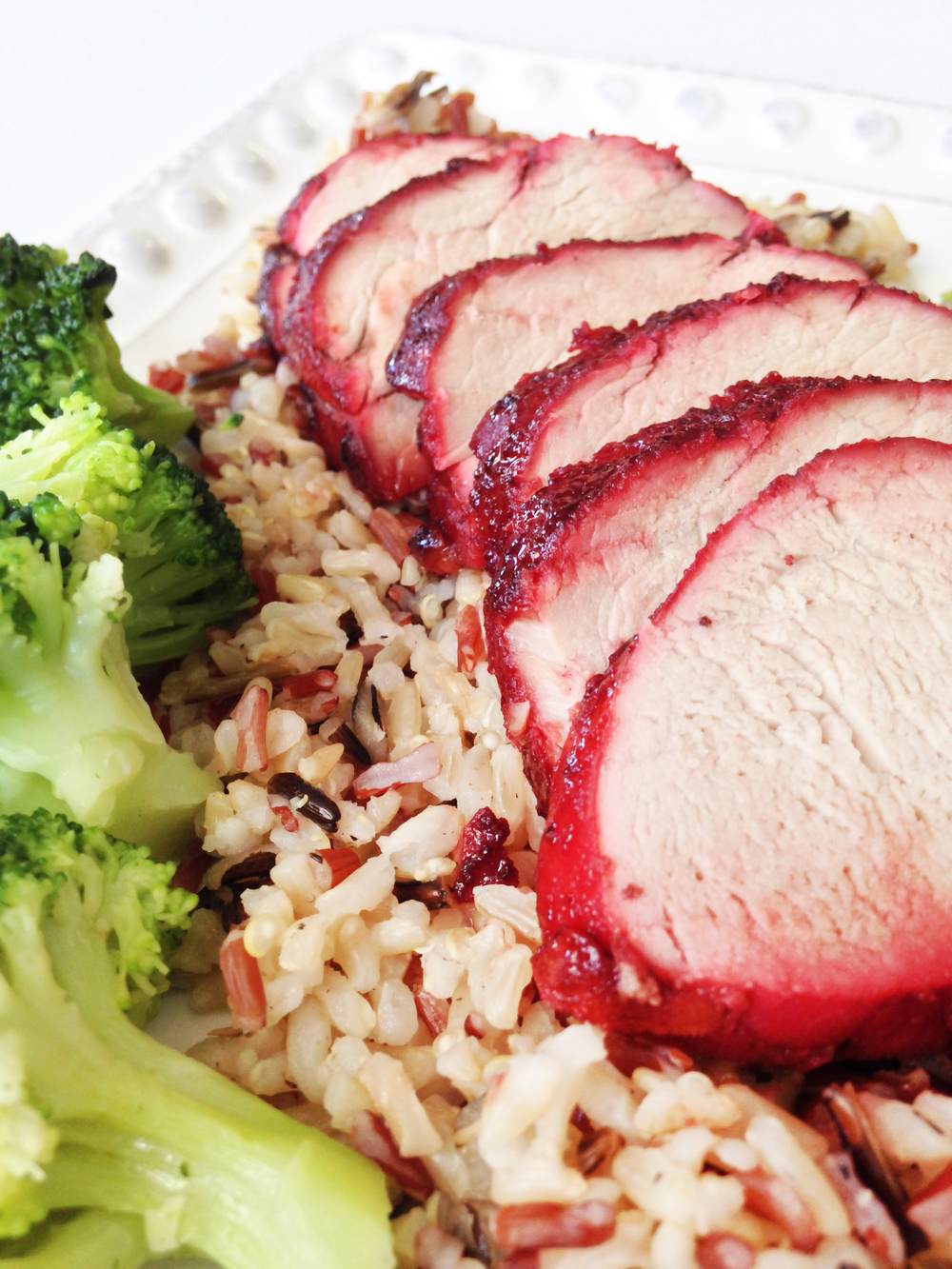 served my pork with steamed broccoli and a rice melody (brown, red ...