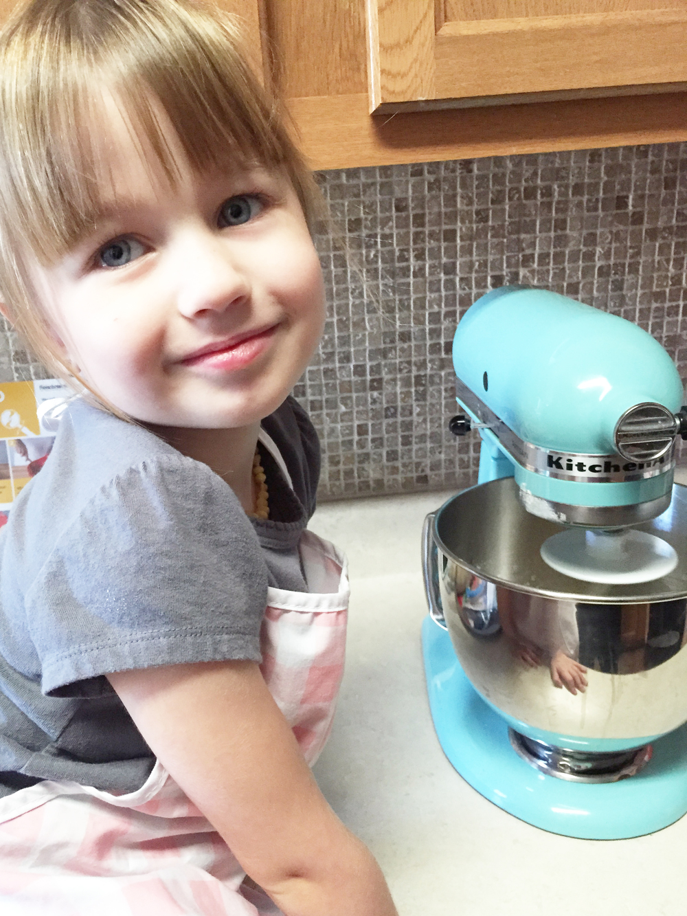 My handy kitchen helper. Hello, beautiful girl! ... Yep. Even has her pink apron on