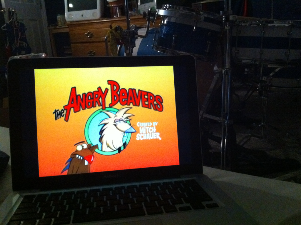Installing software on one computer, watching Angry Beavers on the other.