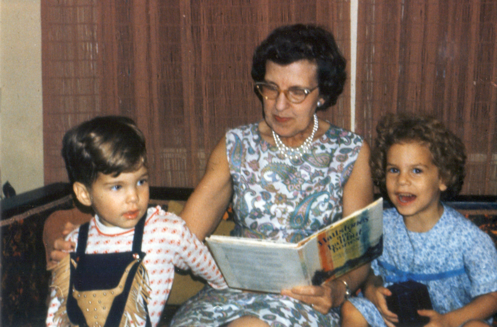 My grandmother reads to my brother and me. No wonder I love books so much. (And I appear to be holding a camera...hhmmmm....)