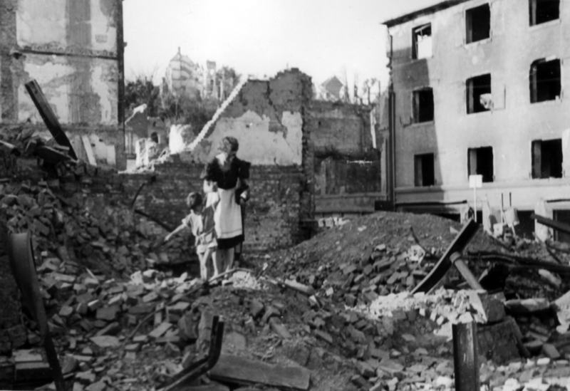 The subjects in this photo comb through the ruins of their apartment building after their city was bombed during World War II. While not all of us have such dramatic photos, look for photos that invoke a strong emotional response.