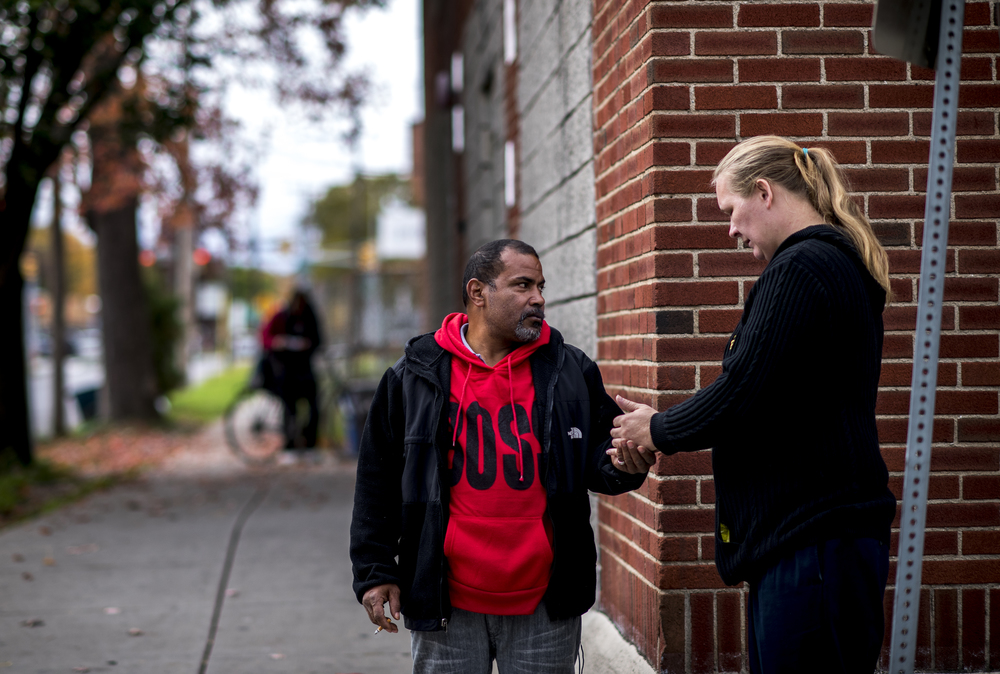 Syracuse resident and former addict Jose Moralles, 47, sells cigarettes outside of the Rescue Mission's thrift store to support his second wife Frances, and his four-month-old son, Jose Jr. Moralles stays in the area around the Rescue Mission in order to cater to the nicotine addiction of the many individuals that receive assistance from the Mission.