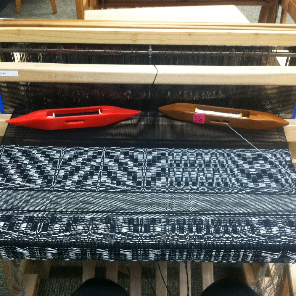 Process shot of the weaving on a 4 harness floor loom.