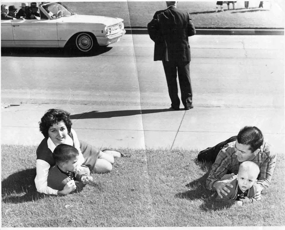 Photo 40- Bill and Gayle Newman and thier children in Dealey Plaza follwong the shots.jpg