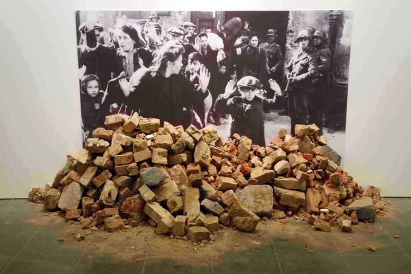 "Gustav Metzger , Historic photographs no. 1 ""Liquidation of the Warsaw Ghetto"". B&W photograph and Rubble, image courtesy of the artist, copyright J.Hardman Jones"