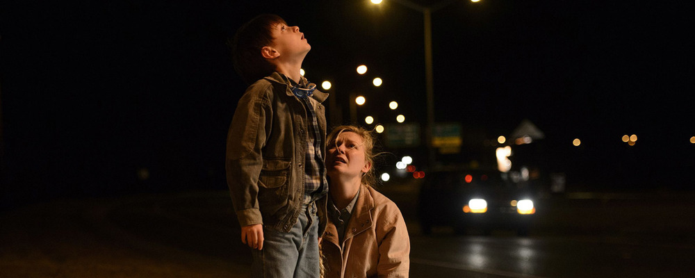 Lieberher  as Alton and  Dunst  as his mother Sarah, reacting to something batshit crazy in  Midnight Special