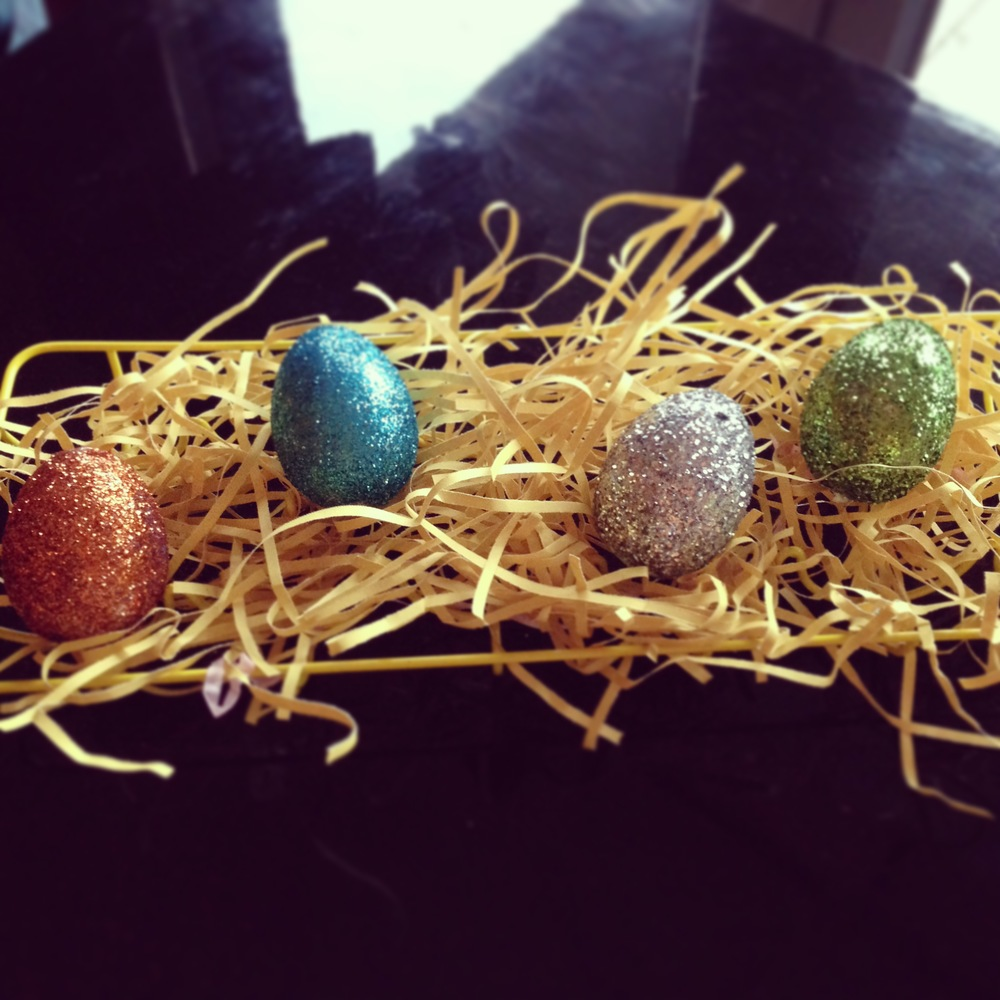 Another way of displaying your decorated eggs - placed in an egg stand with some shredded paper.