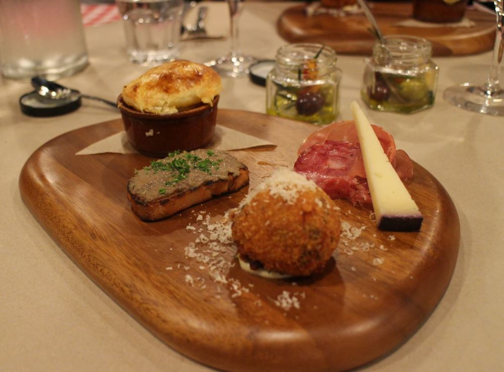 Antipasto plank ~ arancini with polenta mash, farmhouse duck liver parfait on toasted ciabatta, eggplan parmigiana with pie top, prosciutto and cheese Homemade marination in EVO, lemon zest, garlic and fresh herbs